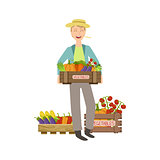 Guy Holding A Wooden Crate Full Of Fresh Vegetables
