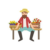 Bearded Farmer Sitting On The Bench With Crates Of Vegetables