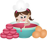 Little girl baking macaroons