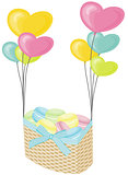 Macaroons on wicker basket with hearts balloons