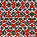 Ornate seamless knitting pattern in warm colors