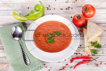 Tomato soup on white table