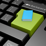 Blue book on green button of computer keyboard