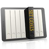 Book and tablet set goals concept