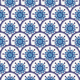 Seamless pattern of circles with blue flowers