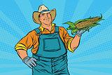Rural farmer with an ear of corn