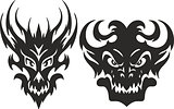Symmetrical monster head tattoos