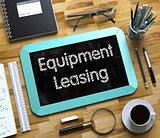 Equipment Leasing - Text on Small Chalkboard. 3D.