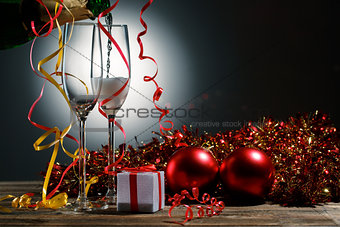 Champagne poured into glasses and Christmas decoration