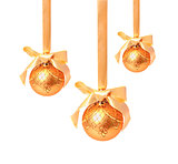 Hunging golden christmas balls isolated on a white