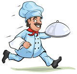 Male chef carries finished dish on platter