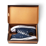 Dark blue sports shoes inside cardboard box