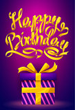Happy Birthday poster - gold ribbon lettering and gift box on purple background.