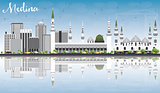 Medina Skyline with Gray Buildings, Blue Sky and Reflections.
