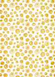 Gold foil decorative background with doodle swirl pattern.