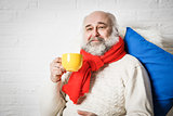 Senior Man with Beard Drinking Tea in Winter
