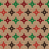Seamless knitting pattern with color crosses over beige