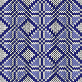 Seamless geometrical knitting pattern in blue and white