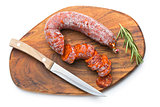 sliced chorizo sausage and cutting board