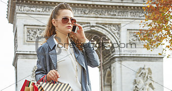 modern woman shopper in Paris, France using smartphone shopper