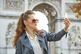 fashion-monger in Paris, France taking selfie with phone