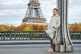 healthy woman on Pont de Bir-Hakeim bridge looking into distance