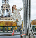 healthy woman against Eiffel tower in Paris looking aside