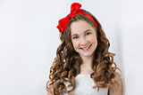 Teen girl with red bow on head