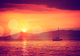 Sailing Yacht in Calm Bay. Sunset Seascape.