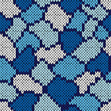 Knitting seamless scrappy pattern in blue and white colors