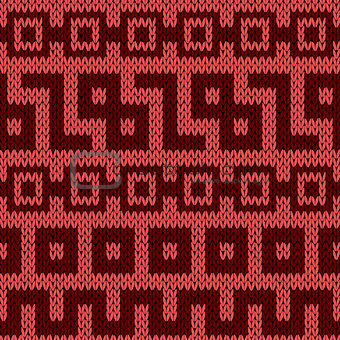 Knitting geometrical seamless pattern in red hues