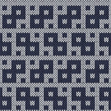 Knitting geometrical seamless pattern in muted blue hues