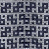 Knitting geometrical seamless pattern in muted blue hues