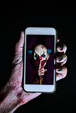 picture of an evil clown in a smartphone