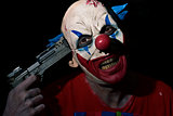 evil clown pointing a gun to his temple