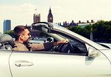 happy man near cabriolet car over london city