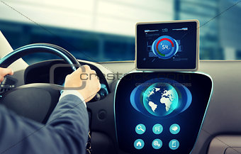 close up of businessman with tablet pc driving car
