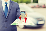 close up of business man with smartphone navigator