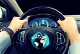 close up of man driving car with globe on screen