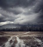 Dark Gloomy Landscape with Country Road in Snow