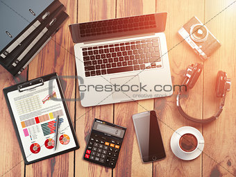 Office workplace. Wooden desk background with laptop, mobile pho