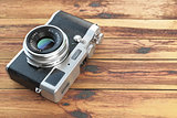 Modern mirrorless camera stilized to retro vintage film camera o