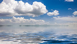 sea and cloudy blue sky
