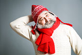 Happy Old Man with Beard in Red Winter Clothes