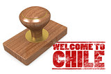 Red rubber stamp with welcome to Chile