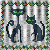 Knitting fabric pattern with two grey cats