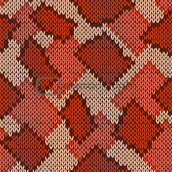 Knitting seamless scrappy pattern in warm hues