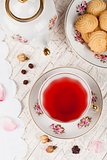 cup of red tea on serving table