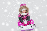 happy little kid on sled outdoors in winter