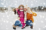 happy family waving hands outdoors in winter